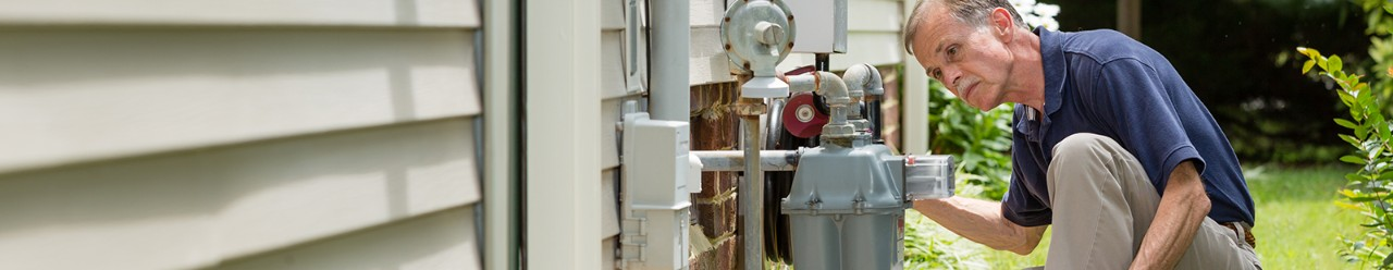 home inspector examines residential gas meter